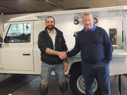 coffee-van-conversion-land-rover-defender-white-side-handshake